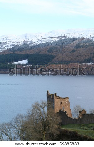 Urquart Castle on the shore of Loch Ness in winter. - stock photo