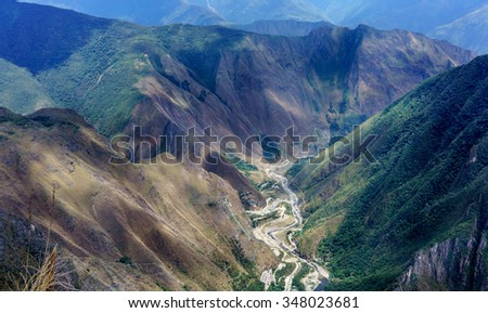 Urubamba river flowing through green Andes, Machu Picchu, Cusco Region, Urubamba Province, Machupicchu District, Peru - stock photo