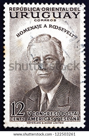 URUGUAY - CIRCA 1953: a stamp printed in the Uruguay shows Franklin Delano Roosevelt, 32nd President of the United States, circa 1953 - stock photo