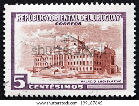 URUGUAY - CIRCA 1954: a stamp printed in the Uruguay shows Legislature Building, Montevideo, circa 1954 - stock photo
