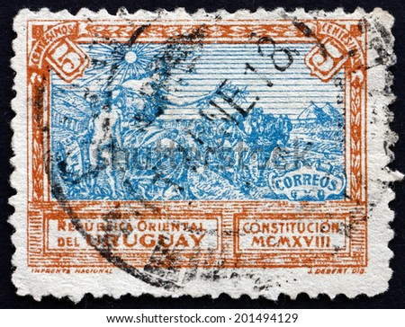 URUGUAY - CIRCA 1918: a stamp printed in the Uruguay shows Liberty Extending Peace to the Country, Promulgation of the Constitution, circa 1918 - stock photo