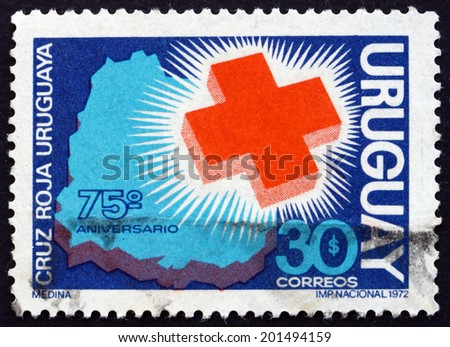 URUGUAY - CIRCA 1972: a stamp printed in the Uruguay shows Red Cross and Map of Uruguay, 75th Anniversary of the Uruguayan Red Cross, circa 1972 - stock photo