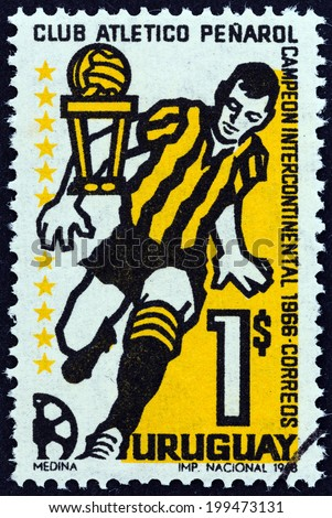 URUGUAY - CIRCA 1968: A stamp printed in Uruguay issued for Penarol Club's Victory in Intercontinental Football Championships shows footballer, circa 1968.  - stock photo