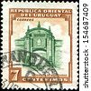URUGUAY - CIRCA 1954: A stamp printed in Uruguay shows Entrance to the Citadel in Montevideo, circa 1954  - stock photo