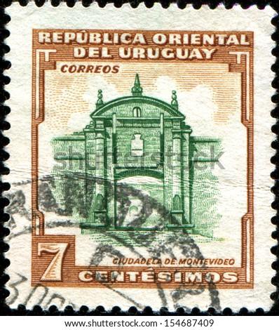 URUGUAY - CIRCA 1954: A stamp printed in Uruguay shows Entrance to the Citadel in Montevideo, circa 1954  - stock photo