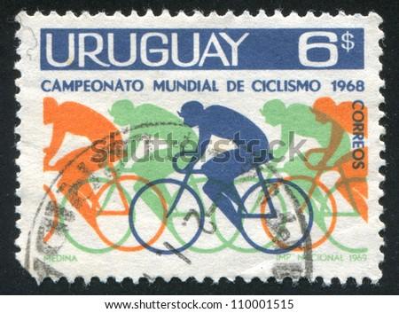 URUGUAY - CIRCA 1969: stamp printed by Uruguay, shows Bicyclists, circa 1969 - stock photo