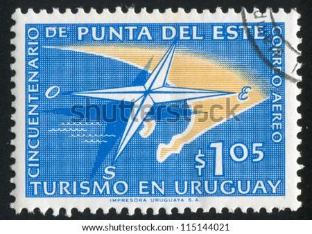 URUGUAY - CIRCA 1959: stamp printed by Uruguay, shows Compass and Map of Punta del Este, circa 1959 - stock photo
