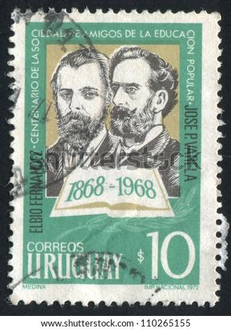 URUGUAY - CIRCA 1973: stamp printed by Uruguay, shows Elbio Fernandez and Jose Varela, circa 1973 - stock photo