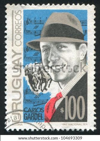 URUGUAY - CIRCA 1974: stamp printed by Uruguay, shows Gardel and Score, circa 1974 - stock photo
