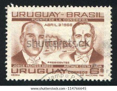 URUGUAY - CIRCA 1968: stamp printed by Uruguay, shows Presidents Jorge Pacheco Areco of Uruguay and Arthur Costa, circa 1968 - stock photo