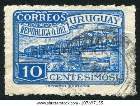 URUGUAY - CIRCA 1948: stamp printed by Uruguay, shows Santa Lucia River Highway Bridge, circa 1948