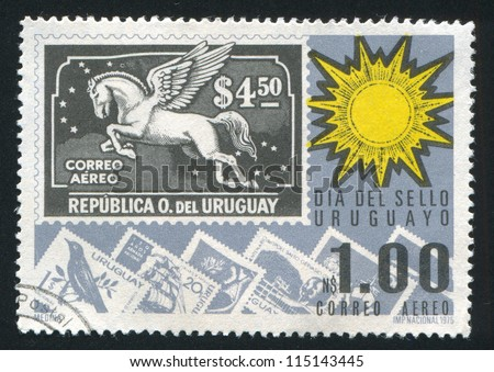 URUGUAY - CIRCA 1975: stamp printed by Uruguay, shows Sun and Stamps, circa 1975 - stock photo