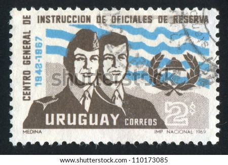 URUGUAY - CIRCA 1969: stamp printed by Uruguay, shows Training Center Emblem and Officer in Uniform and as Civilian, circa 1969