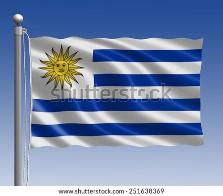 Uruguay flag in pole on blue sky background - stock photo