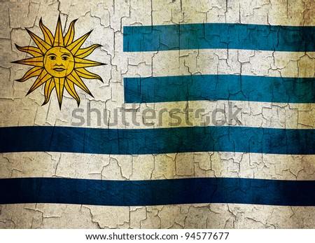 Uruguayan flag on a cracked grunge background - stock photo