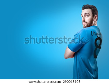 Uruguayan soccer player on blue background - stock photo