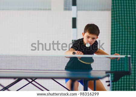 URYUPINSK- RUSSIA - MARCH 17: athlete indoor table tennis indoor, ping-pong, Maxim Nevedrov (pictured), 14 Open Championship of memory Uryupinsk NS Demidenko, Uryupinsk-Russia, March 17 2012. - stock photo
