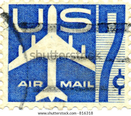 US Air Mail Stamp, seven cents from the 1970s showing a jet plane and a large number 7 seven. - stock photo
