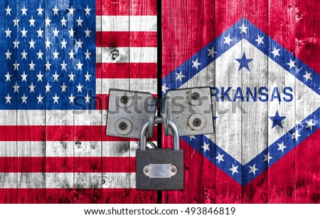 US and Arkansas flag on door with padlock