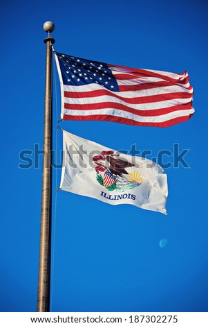 US and Illinois flags against blue sky - stock photo