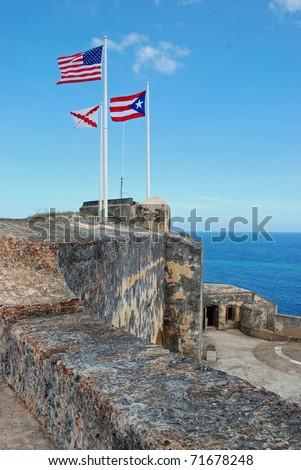 US and Puerto Rican Flags at El Morro castle; San Juan, Puerto Rico - stock photo