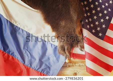 US and Russian flags on the bearskin rug - stock photo