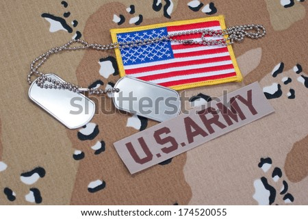 US ARMY concept with dog tags on camouflage uniform - stock photo