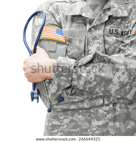 US Army doctor holding stethoscope near his shoulder - studio shot - stock photo
