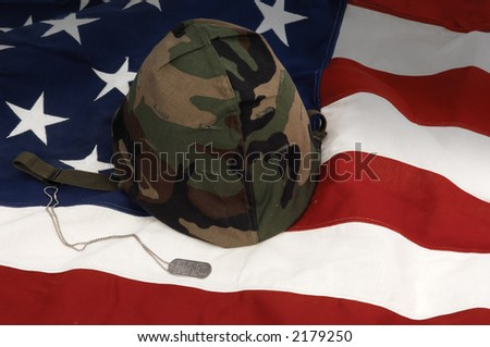 US Army helmet and dog tag on US flag background - stock photo