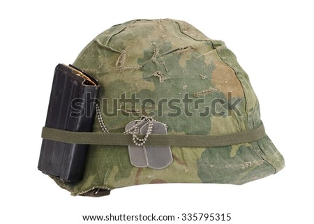 US Army helmet Vietnam war period with camouflage cover, magazine with ammot and dog tags isolated on white - stock photo