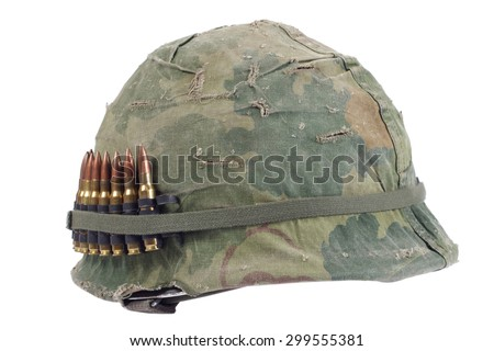 US Army helmet with camouflage cover and ammo belt - Vietnam war period isolated - stock photo