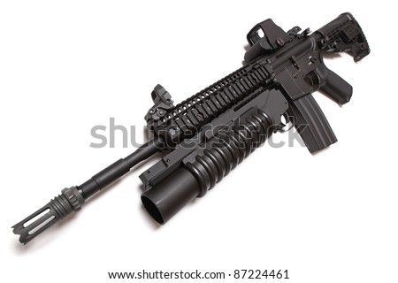 US Army M4A1 tactical carbine with M203 grenade louncher. Isolated on a white background. Taken with a wide angle lens. Studio shot. Weapon series.