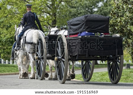 US Army marine funeral coffin on the horse coach - stock photo