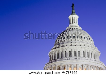 US Capitol Building Dome at dusk, blue sky Washington DC.  United States Of America - stock photo