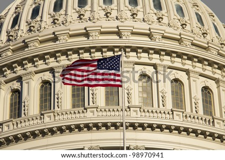 US Capitol Building Dome detail with American Flag, Washington DC.