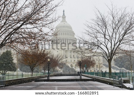 US Capitol building in snow - Washington DC, United States - stock photo