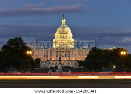 US Capitol Building with car lights trails foreground at night