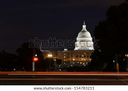 US Capitol Building with car lights trails foreground at night  - stock photo