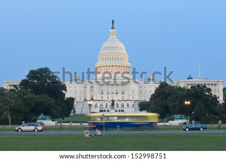 US Capitol building with street traffic foreground in Washington DC - Long exposure - stock photo