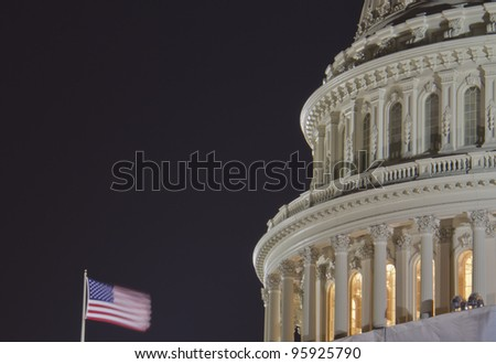 US Capitol dome detail with American Flag at night - Washington DC USA, close up view - stock photo