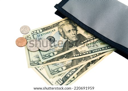 US Cash and coins spilling out of a green wallet.  - stock photo