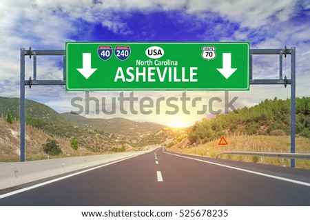 US city Asheville road sign on highway