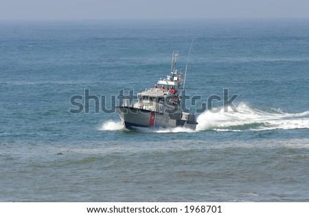 US Coast Guard boat in rescue mission off California coast - stock photo