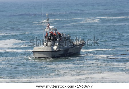 US Coast Guard boat in rescue operation off California coast - stock photo