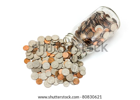 US Coins Spilled Out Of A Jar  Onto A White Background - stock photo
