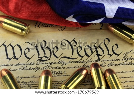 US Constitution Bill of Rights with 45 caliber bullets and American flag - stock photo