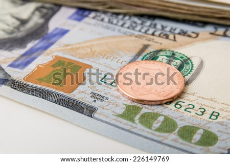 US Currency with one dollar coins - stock photo