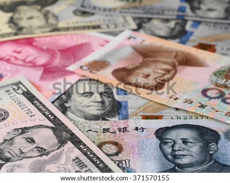 US dollar and chinese yuan background, global economy finance trade business, money closeup - stock photo