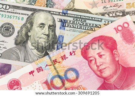 US Dollar and Chinese Yuan banknote money - stock photo