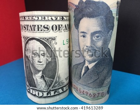 US dollar and Japanese yen banknotes representing exchange rate